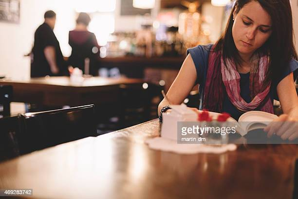 Woman reading a book in the coffee shop