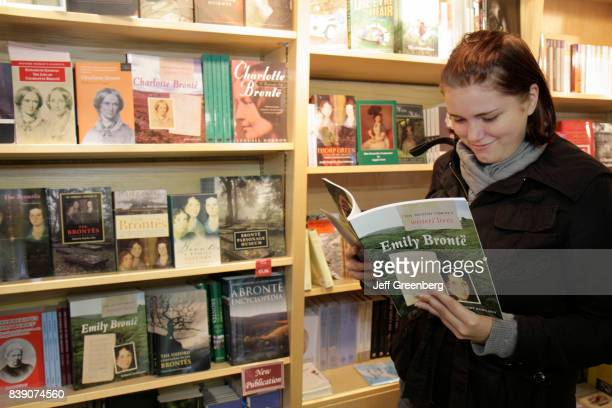 A woman reading a book in the gift shop at the Bronte Parsonage Museum