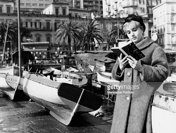 A woman reading a book in the Mergellina area at the foot of Posillipo hill Naples 1963