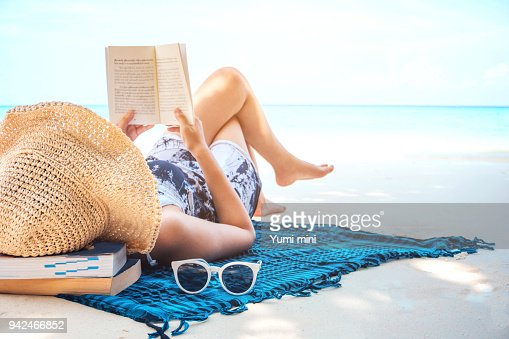 Woman  reading a book on the beach in free time summer holiday : Stock Photo