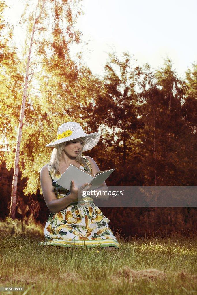 Woman reading a book : Bildbanksbilder