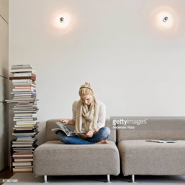 Woman reading a stack of books
