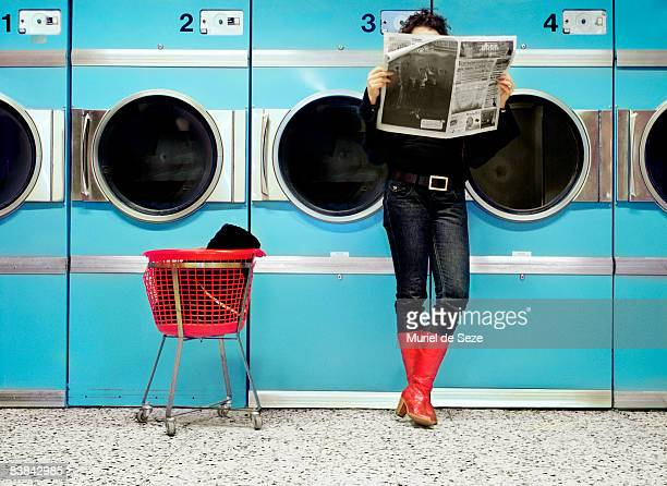Woman reading at laundromat