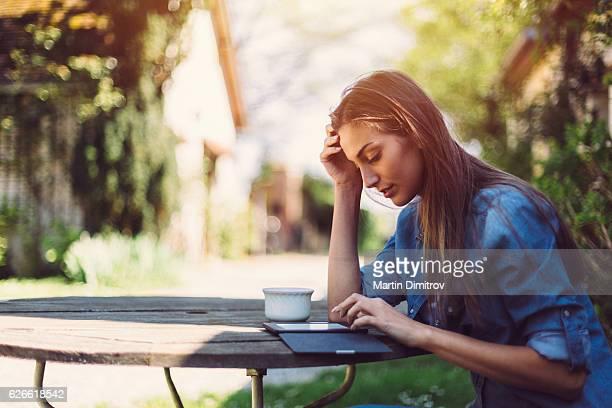 Woman reading book among nature