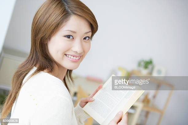 Woman reading book smiling