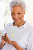 Woman reading card and smiling