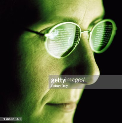 Woman reading computer screen, reflection in glasses : Stock Photo