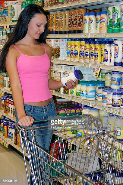 Woman reading food label at a grocery store