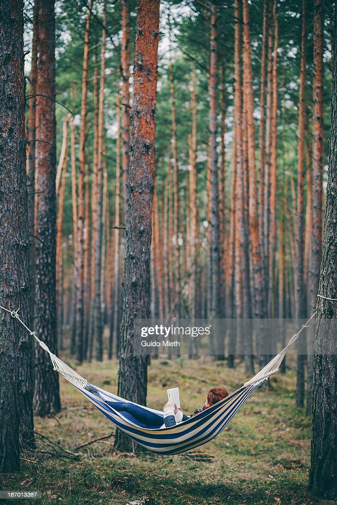 Woman reading in a hammock.