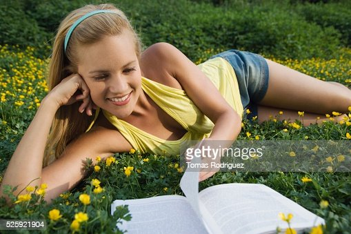Woman Reading in a Meadow : Stock Photo
