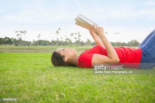 Woman reading in grass