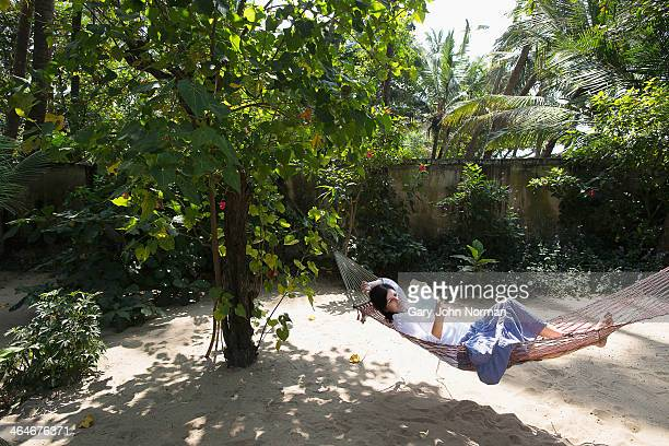 woman reading in hammock at homestay in India