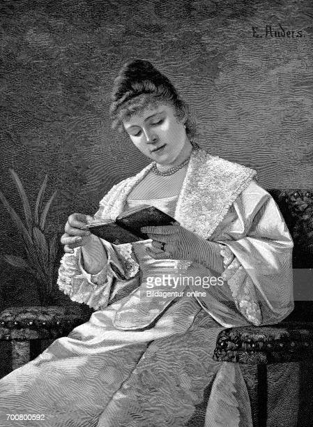 Woman reading lost in a book Wood engraving after a painting by Anders Woodcut from 1892