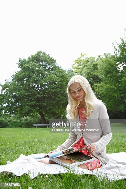 Woman reading magazine in park