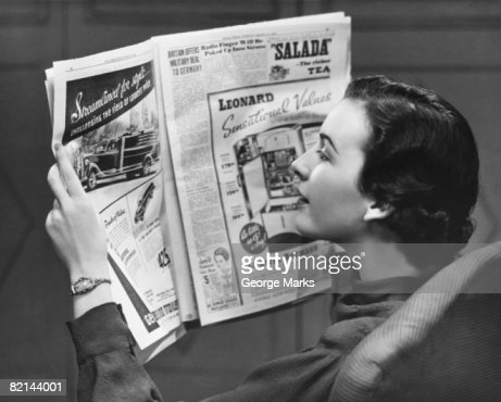 Woman reading newspaper, (B&W) : Stock Photo