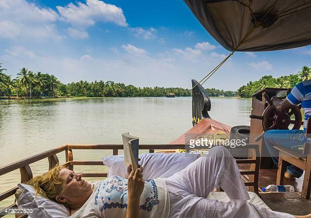 Woman reading on the Kerala Backwaters