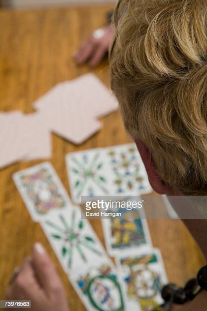 A woman reading tarot cards at a table