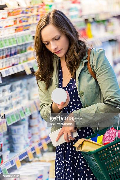 Woman reading yogurt label