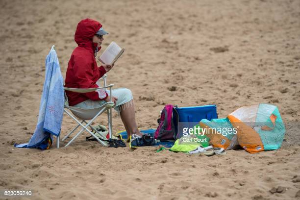 A woman reads a book as she relaxes on the beach on July 26 2017 in Broadstairs England Broadstairs is known as the 'jewel in Thanet's crown' and is...