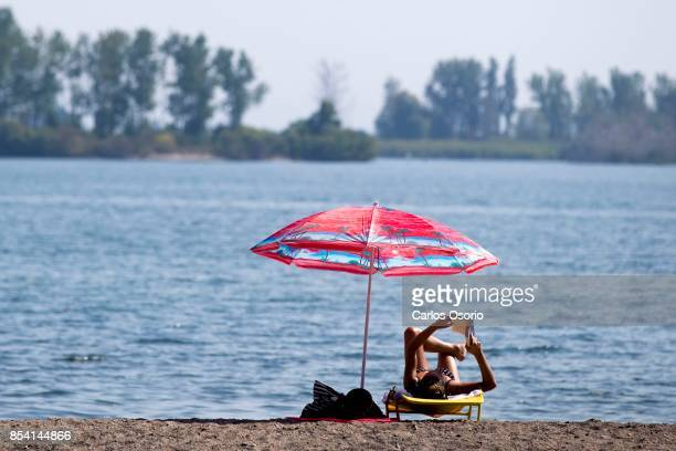 TORONTO ON SEPTEMBER 25 A woman reads a book at Cherry Beach in Toronto on September 25 2017