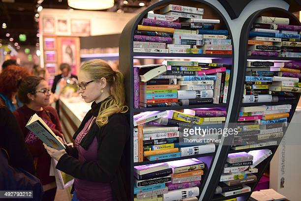 A woman reads a book at the 2015 Frankfurt Book Fair on October 15 2015 in Frankfurt am Main Germany The 2015 fair which is among the world's largest...