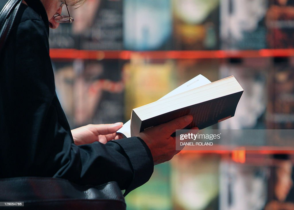 A woman reads a book at the 63rd Frankfurt Book Fair (Frankfurter Buchmesse) October 12, 2011 in Frankfurt/M., western Germany. This year's edition of the largest book fair in the world takes place from October 12 - 16, and features Iceland as guest of honour. AFP PHOTO / DANIEL ROLAND