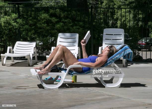 A woman reads a book by the pool at Rancho Oso Resort in Santa Barbara County's backcountry on May 13 near Santa Ynez California Located 45 minutes...