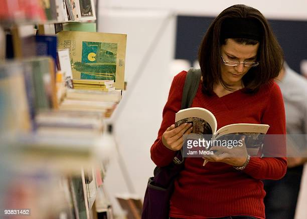 Woman reads a book during the Guadalajara International Book Fair 2009 at the Expo Guadalajara on December 3 2009 in Guadalajara Mexico