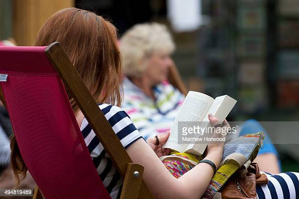 A woman reads a book during the Hay Festival on May 31 2014 in HayonWye Wales The Hay Festival is an annual festival of literature and arts which...