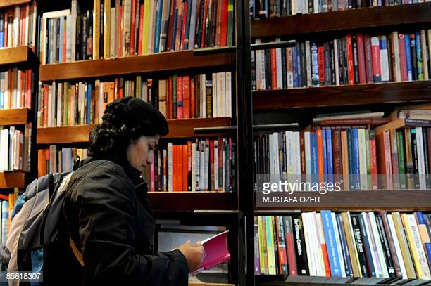 A woman reads a book in a bookstore in Istanbul on March 26 2009 According to The Turkish Independent Union of Pedagogues the average of people...
