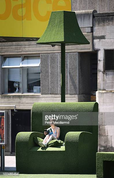 A woman reads a book in a giant grass covered armchair at the Southbank Centre on June 28 2010 in London England The United Kingdom is experiencing a...