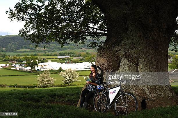 A woman reads a book in fine weather during the first day of the Guardian Hay Festival Sky Arts once again returns to The Guardian Hay Festival 2009...