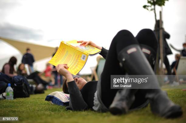 A woman reads a book in fine weather during the third day of the Guardian Hay Festival Sky Arts once again returns to The Guardian Hay Festival 2009...