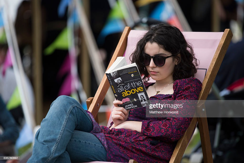 A woman reads a book in the warm summer weather during the 2016 Hay Festival on May 29, 2016 in Hay-on-Wye, Wales. The Hay Festival is an annual festival of literature and arts now in its 29th year.
