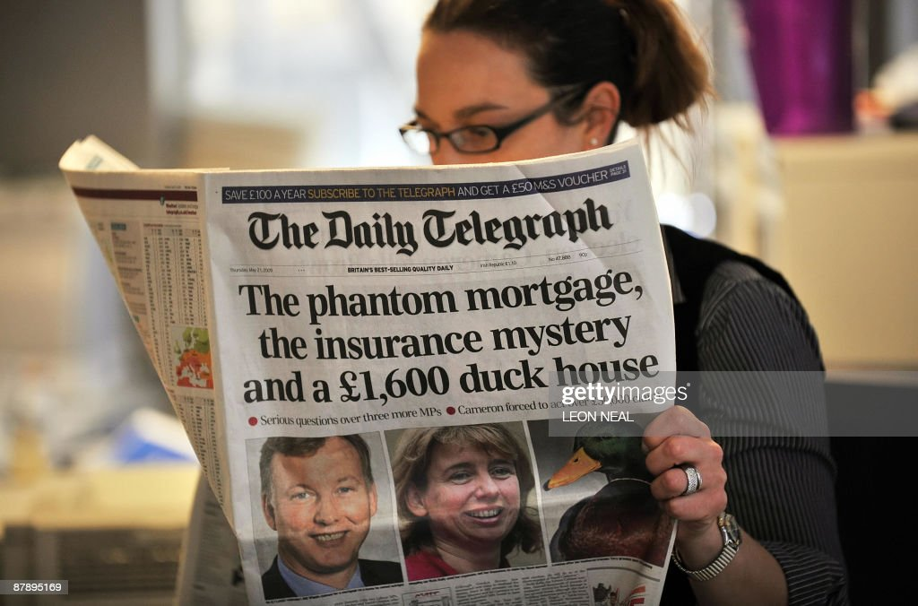 A woman reads a copy of the Daily Telegraph newspaper in London, on May 21, 2009. Britain's political expenses row threw up a new embarrassing revelation Thursday, as an opposition lawmaker was forced to quit after claiming 1,600 pounds (2,500 dollars, 1,800 euros) for a 'duck island.' The latest resignation emerged as Prime Minister Gordon Brown defended two of his ministers in the spotlight over expenses claims. A string of revelations over the past two weeks has rocked British politics. Senior Conservative MP Sir Peter Viggers bought the wooden structure -- providing a comfortable retreat for ducks in the middle of a garden pond -- for his home in Hampshire, southern England, The Daily Telegraph newspaper said. AFP PHOTO/Leon Neal