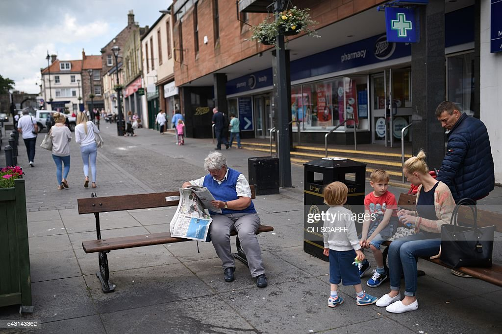 A woman reads a newspaper on a bench in the centre of the border town of Berwick-upon-Tweed in northern England close to the border between England and Scotland on June 26, 2016. Scotland's First Minister Nicola Sturgeon campaigned strongly for Britain to remain in the EU, but the vote to leave has given the Scottish National Party leader a fresh shot at securing independence. Sturgeon predicted more than a year ago that a British vote to leave the alliance would give pro-European Scots cause to hold a second referendum on breaking with the UK. SCARFF