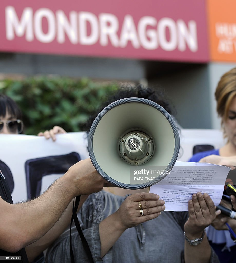 A woman reads a statement after a demonstration called by workers of Spanish electrical appliance maker Fagor which has filed for protection from creditors, on October 18, 2013, in the northern Spanish Basque town of Mondragon. The maker of everything from small appliances to washing machines, fridges and kitchen furniture said it had started negotiations to restructure its debt, estimated by the Spanish media at 800 million euros ($1.1 billion). AFP PHOTO / RAFA RIVAS
