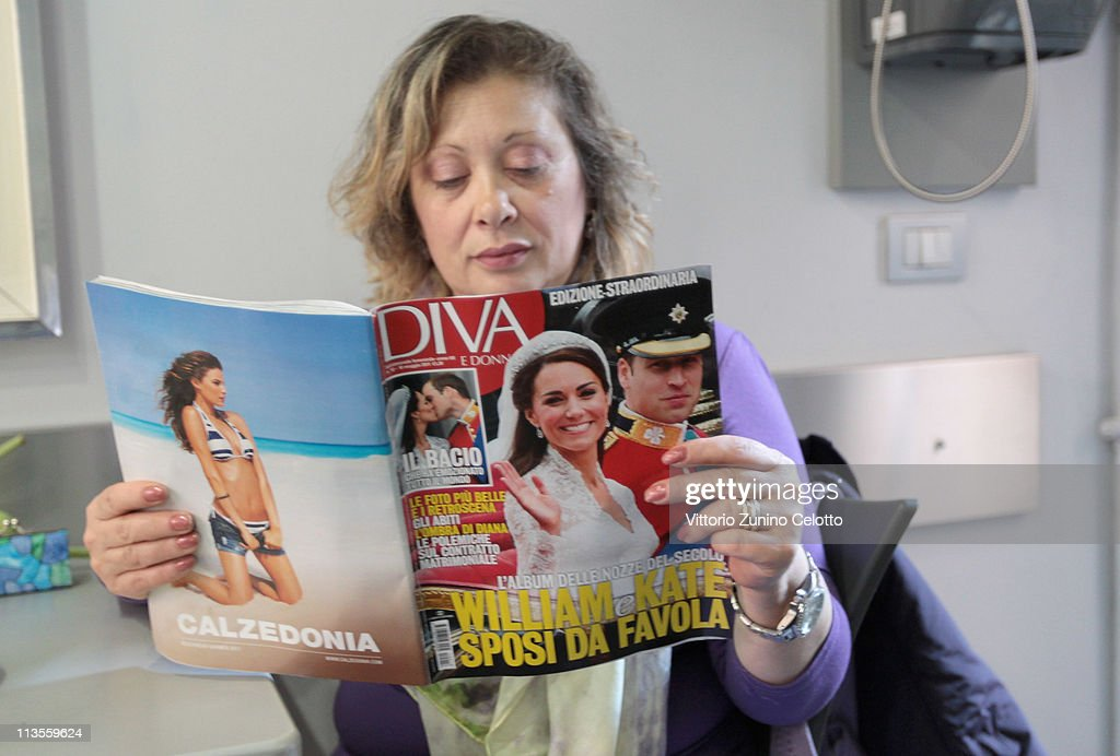 A woman reads an Italian magazine that shows pictures of the the Royal Highnesses Prince William, Duke of Cambridge and Catherine, Duchess of Cambridge on May 03, 2011 in Milan, Italy. The marriage of the second in line to the British throne was led by the Archbishop of Canterbury and was attended by 1900 guests, including foreign Royal family members and heads of state. Thousands of well-wishers from around the world flocked to London to witness the spectacle and pageantry of the Royal Wedding.