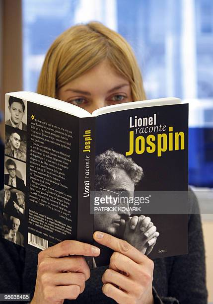 A woman reads former France prime minister Lionel Jospin's book cover 'Lionel raconte Jospin' on January 6 2010 in Paris The documentary film 'Lionel...