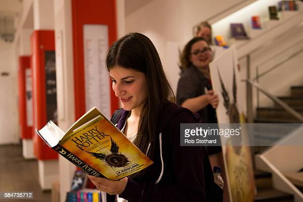 A woman reads J K Rowling's 'Harry Potter and The Cursed Child' a little after midnight at Foyles book store on July 31 2016 in London England The...