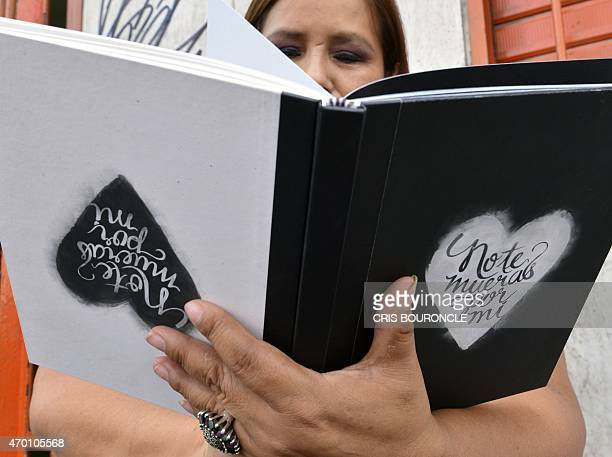 A woman reads on April 17 2015 in Lima the book No te mueras por mi The book which compiles 25 reallife letters and messages from men to women asking...