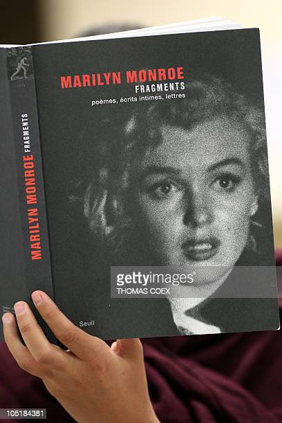 DANS 'FRAGMENTS' A woman reads on October 1 2010 in Paris 'Fragments' a collection of notes letters and poems wrote by US actress Marilyn Monroe and...