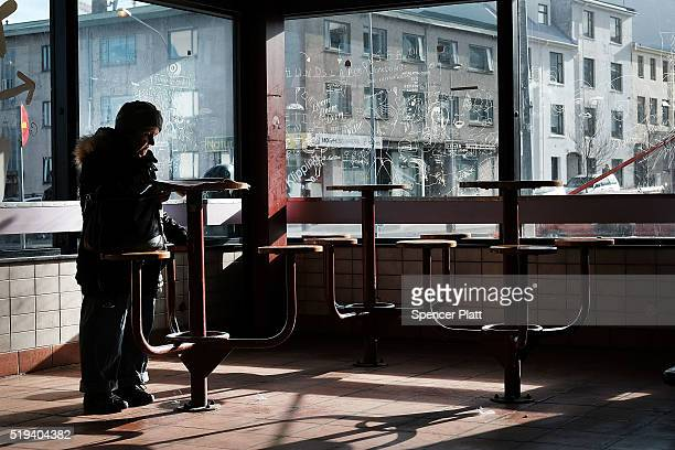A woman reads the paper in a bus station on April 6 2016 in Reykjavik Iceland Icelandic Prime Minister Sigmundur David Gunnlaugsson has stepped down...