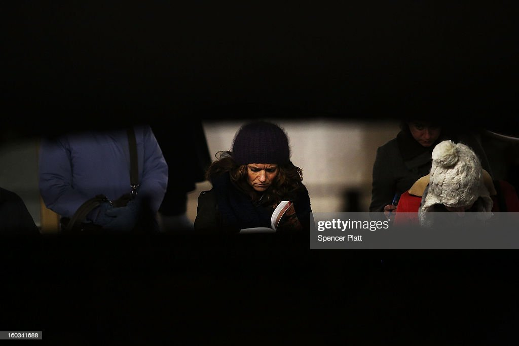 A woman reads while waiting for a subway at a Manhattan station on January 29, 2013 in New York City. The city has been experiencing a rash of high-profile incidents involving individuals being hit by trains in suicides, accidents and people being pushed to their deaths. Lawmakers are planning to discuss the recent deaths while also seeking ideas for more safety on the tracks. The New York City subway system, with 468 stations in operation, is the most extensive public transportation system in the world. It is also one of the world's oldest public transit systems, with the first underground line of the subway opening on October 27, 1904.