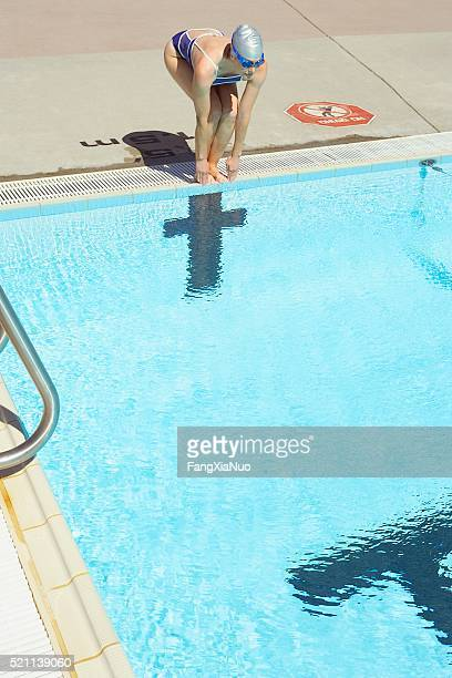 Woman ready to dive into swimming pool