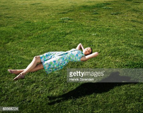 Woman realxing floating above the grass
