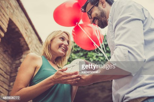 Woman receives a gift from her man stock photo getty images woman receives a gift from her man stock photo negle Images