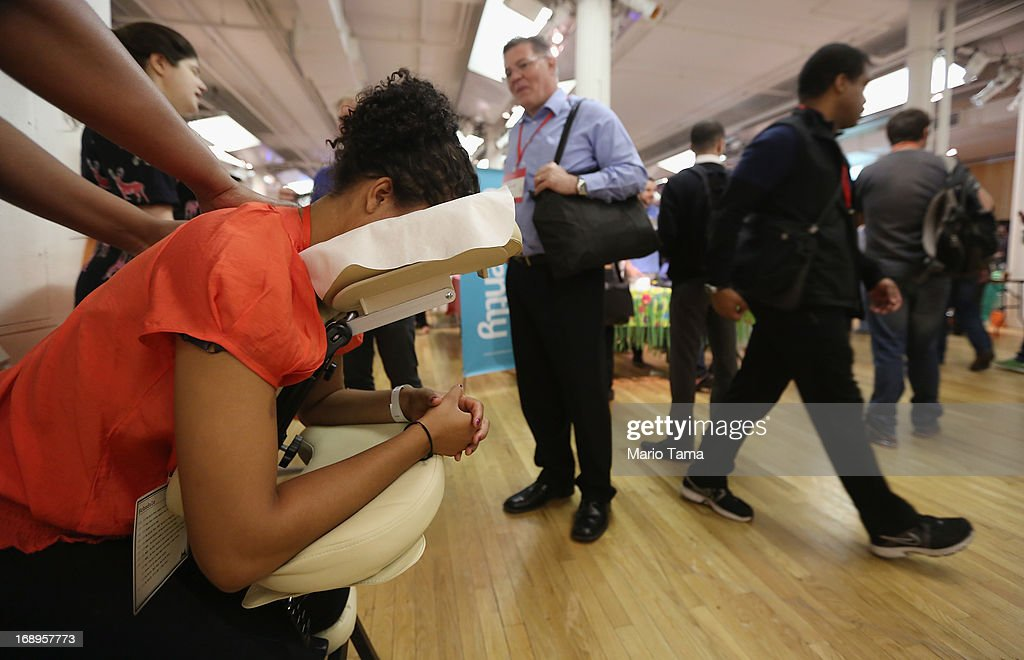 A woman receives a massage while attending the NYC Uncubed tech recruiting event on May 17, 2013 in New York City. 1,100 people were expected to attend the unconventional employment event featuring 50 New York City based startups offering skills classes, ping pong, and beer and wine. Around 1,000 tech companies now operate in the city with the industry having grown by 30 percent since 2005.