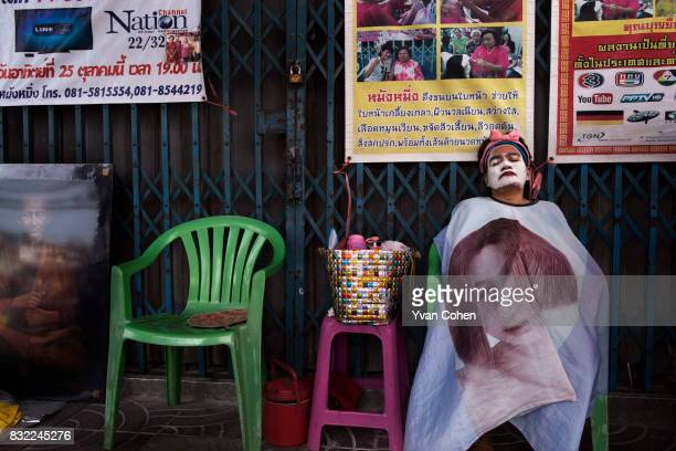 A woman receives facial beauty treatment by the side of the road in the Yaowaraj or Chinatown area of Bangkok