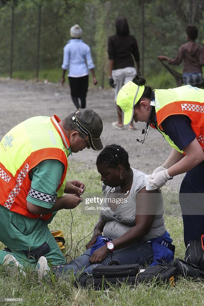A woman receives medical attention after collapsing durning an illegal march on January 21, 2013, in Sasolburg, South Africa. Residents of the Zamdea township protested in anger because of the announced merger of their municipality (Metsimaholo and Ngwathe in Parys.